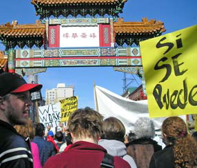 Immigration March passes through Chinatown, Portland, Oregon, March 4, 2006.